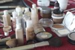 Items of make-up on a table at at outdoor Miceli Productions' photo shoot.