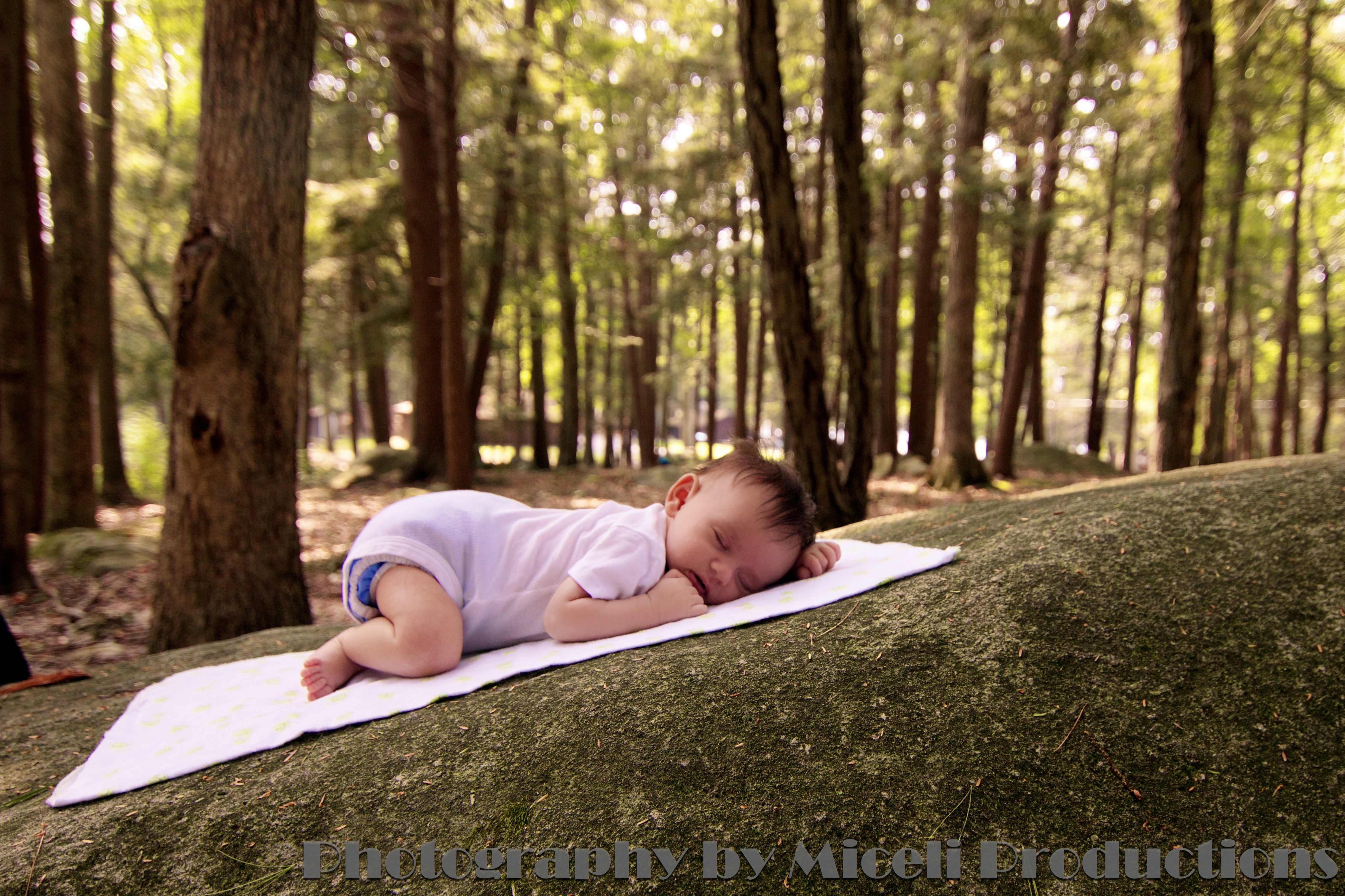 Baby sleeping on a rock in a Connecticut state forest, Photography by Miceli Productions