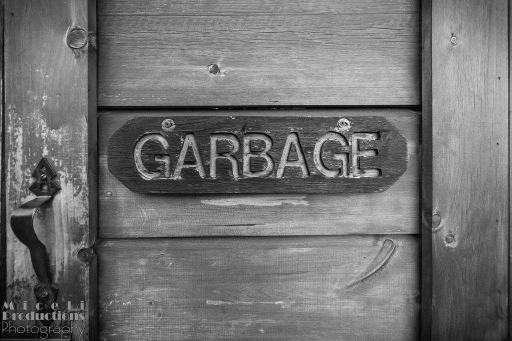 "Three slats of wood on the from of a garbage can with the word ""Garbage"" routed into the center section. © Miceli Productions Photography"