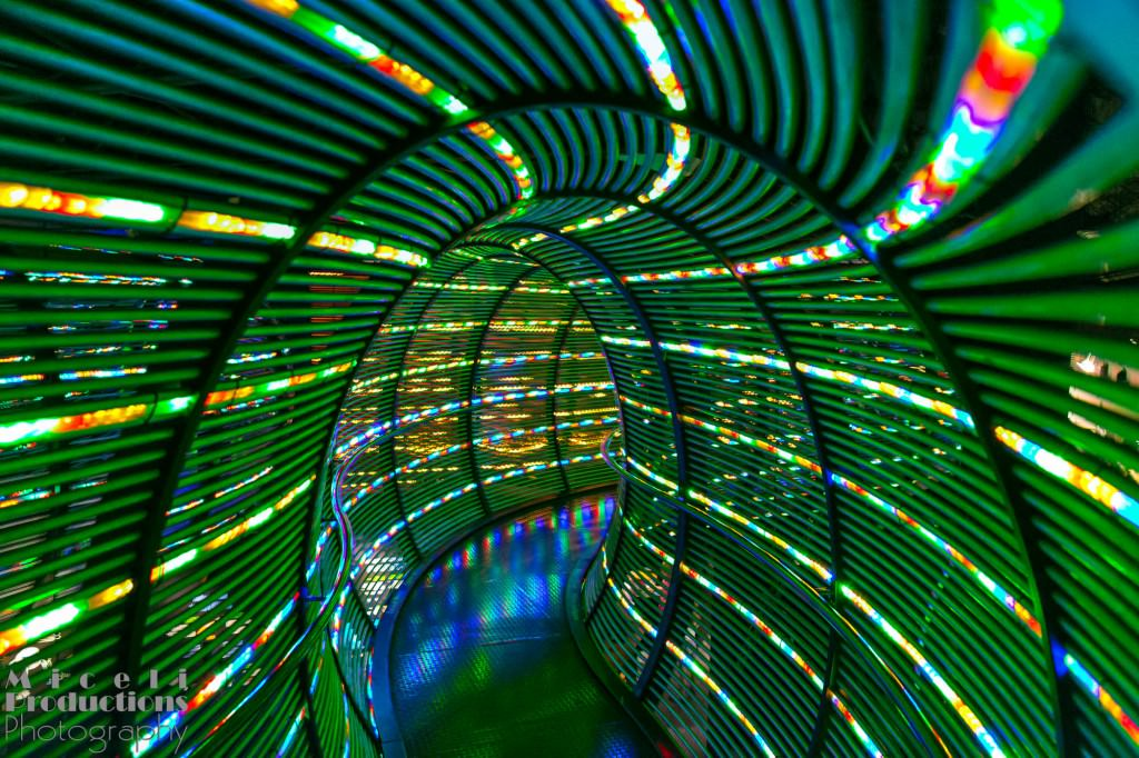 A tunnel of green fibre optic cables. © Miceli Productions Photography