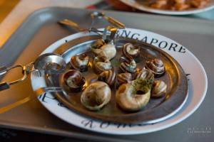 A plate of escargot in shells
