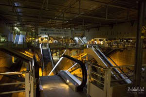 Escalators converge in a Paris Train Station showing a very bare, but industrial and machinery based image of travel.