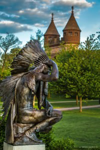 Statue of an American Indian Chief looking off into the distance with his hand raised to shield his eyes. Statue is located in Bushnell Park, Hartford CT. Photo by Miceli Productions.