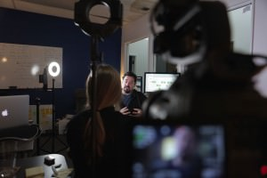 Filming interviews with Miceli Productions. This is a photo of an on-camera interview.