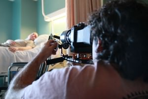 Photo of Michael Miceli filming a scene in a hospital.