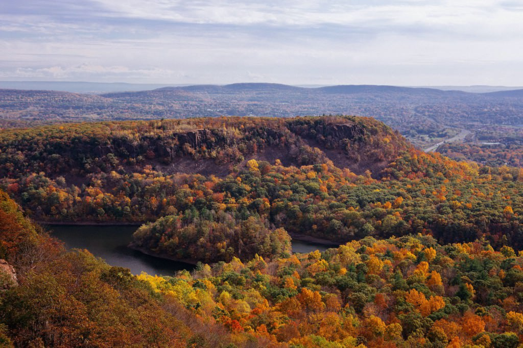 Autumn in New England, Hubbard Park, Meriden CT. A view of fall foliage overlooking water below from Castle Craig.