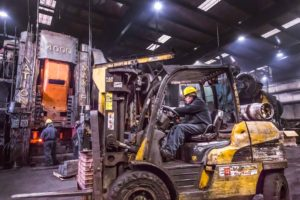 Industrail photography by Miceli Productions, Hartford CT, New Haven CT. Image of man driving a forklift.