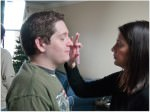 On locaiton make-up being applied to an actor on set.